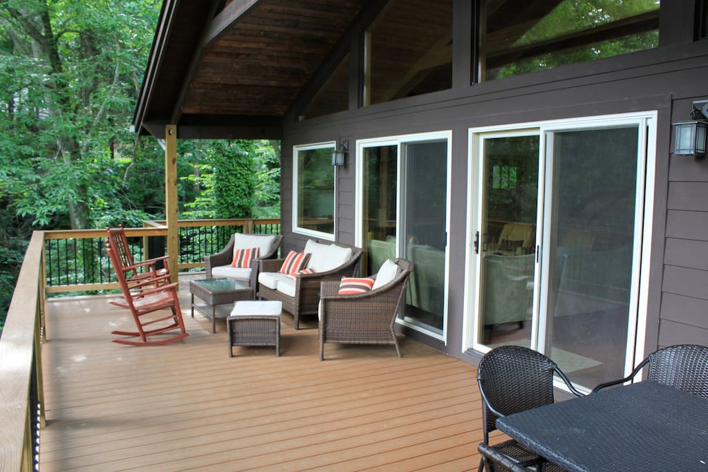 Back Deck, accessible from the sliding glass door of the common area. Easy access to the kitchen.