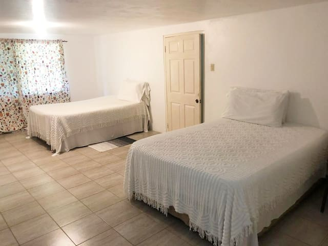 Spacious Bedroom with Two Queen Beds  and Flat Screen TV