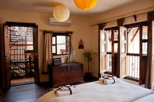 Bed side view with direct access to   beautiful roof terrace  and big windows opening onto a peaceful courtyard