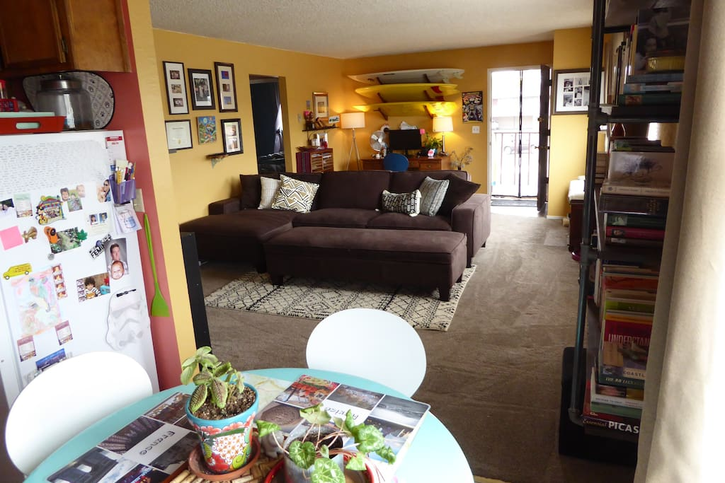 The living and dining areas are bright thanks to a wall of windows. At night, you can open them up and hear the sea lions from the harbor (1 block away).