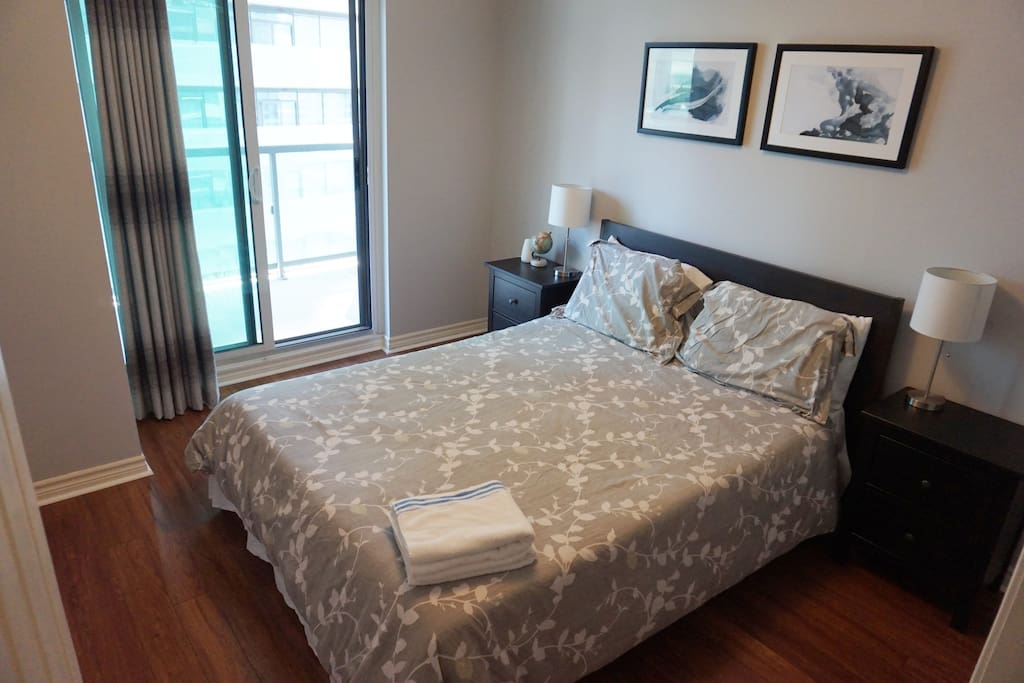 Bedroom with queen-sized bed and new hardwood flooring
