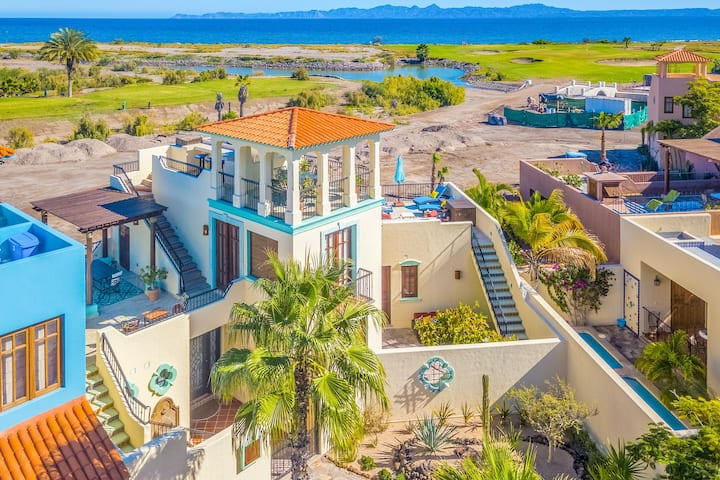 Vibrant house with golf/ocean views, shared pool, partial AC, WiFi & gas grill!