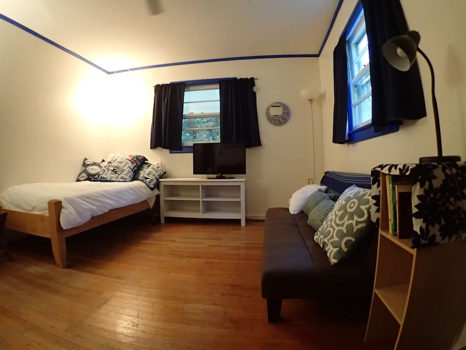 Possibly room for 2-3 people total, extra long twin bed and futon that pulls out into a full size bed.