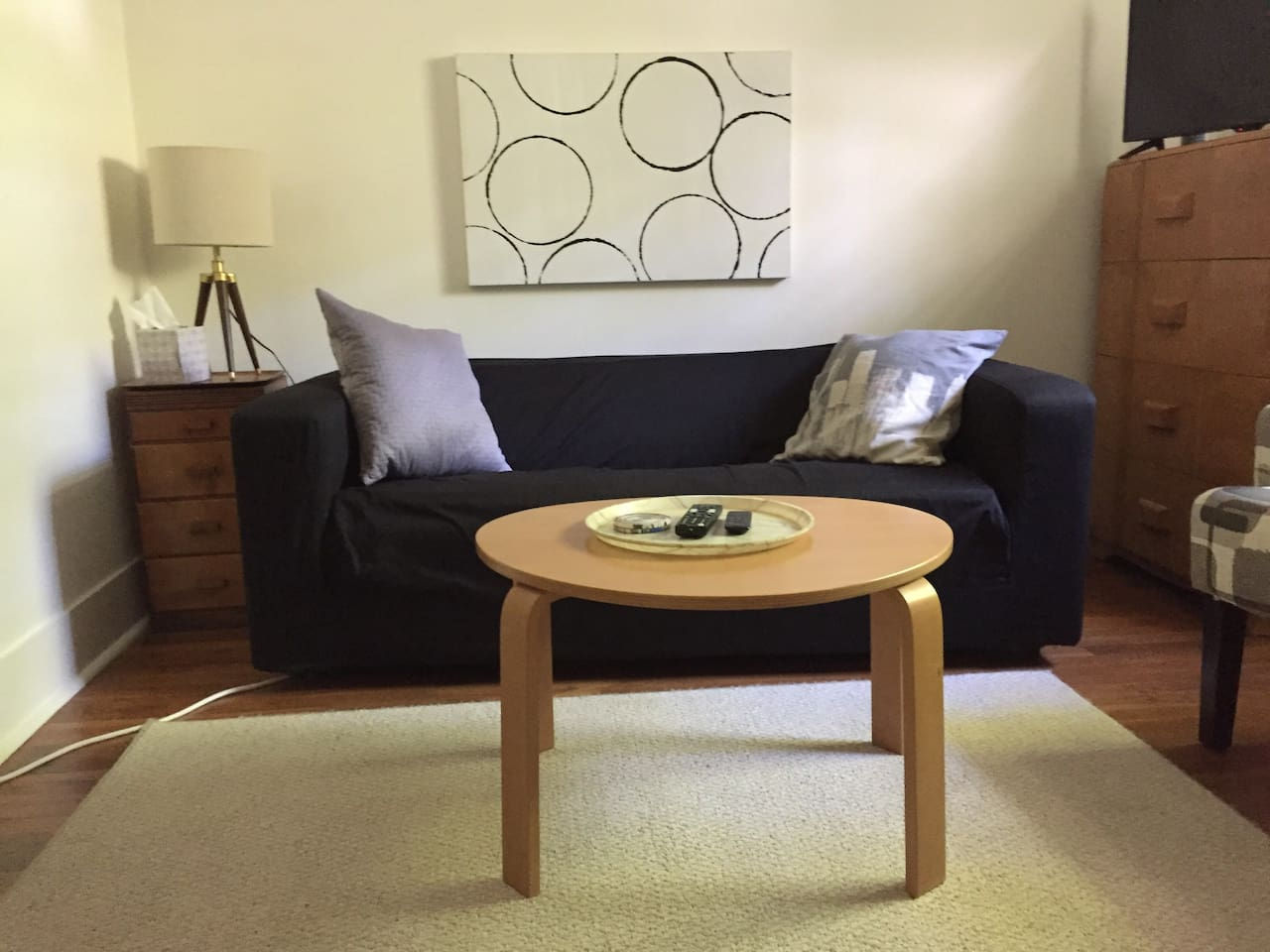 Make yourself at home in this simple and welcoming room. Mid Century meets Ikea, newly refinished floors, freshly painted white. Fridge, microwave, AC, TV, WiFi.