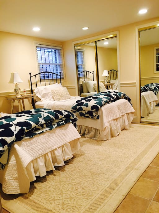 Bedroom with two twin beds that can also be pushed together to create one big bed.  There is also a queen blow up bed.