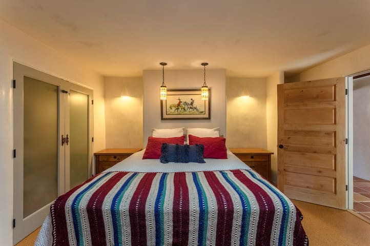 2nd extra large bedroom with brand new Serta king bed and twin trundle bed with sky lights and large window looking out to the backyard full of fruit trees and rose bushes.