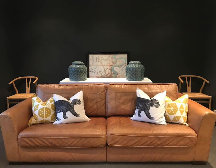 The very comfortable 3 seater leather sofa. The picture in the background is soon to be hung up!