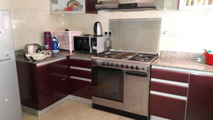 Kitchen areas fully furnitured with kitchen utensils