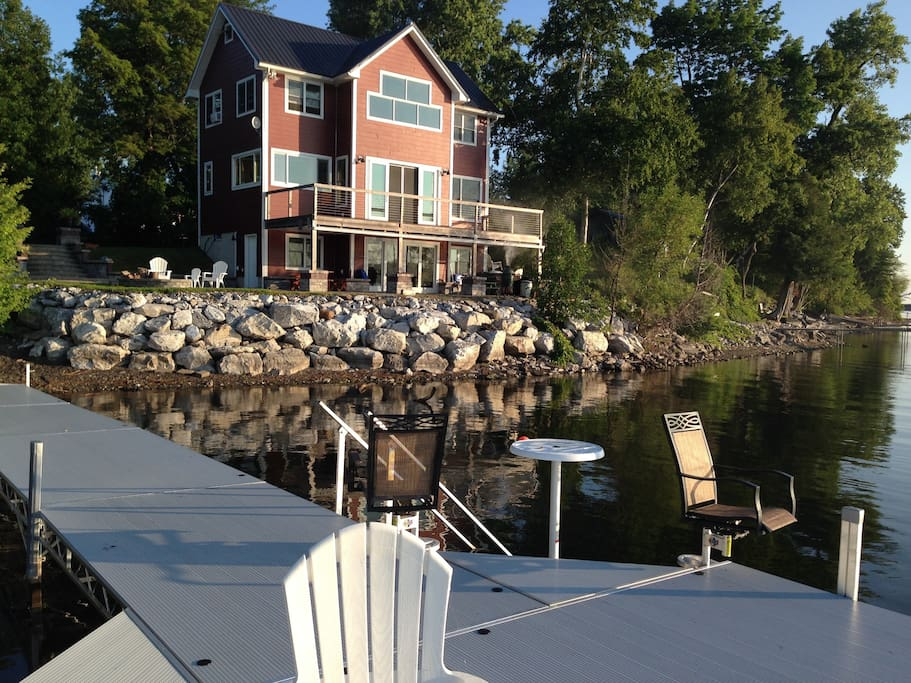 6 foot wide dock with large platform. House has walkout basement and deck off first floor.