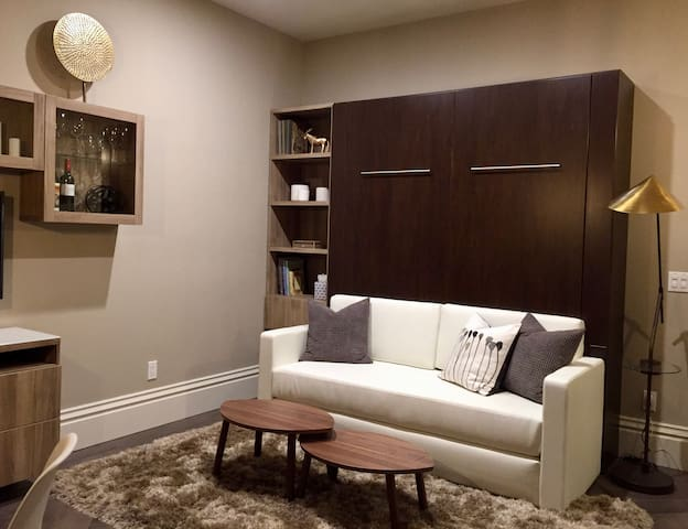 Living space is created when Murphy bed is closed.