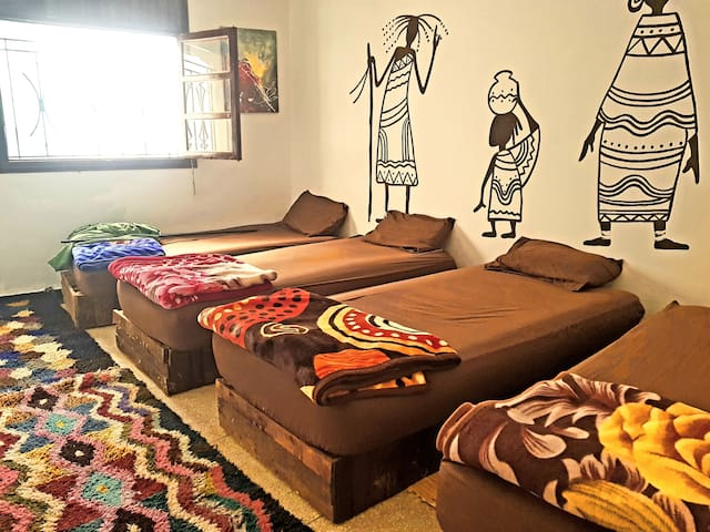 The largest 4 shared Room & Roof House Hostel