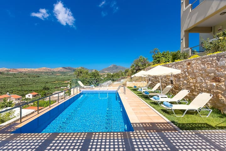 The lawn covered pool area is equipped with sun beds and parasols!