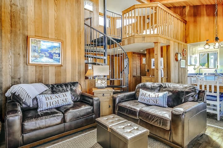 Eclectic coastal retreat w/ ocean view, private hot tub & spacious lofted layout