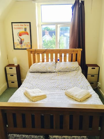 Double room in a top floor flat close to stadium