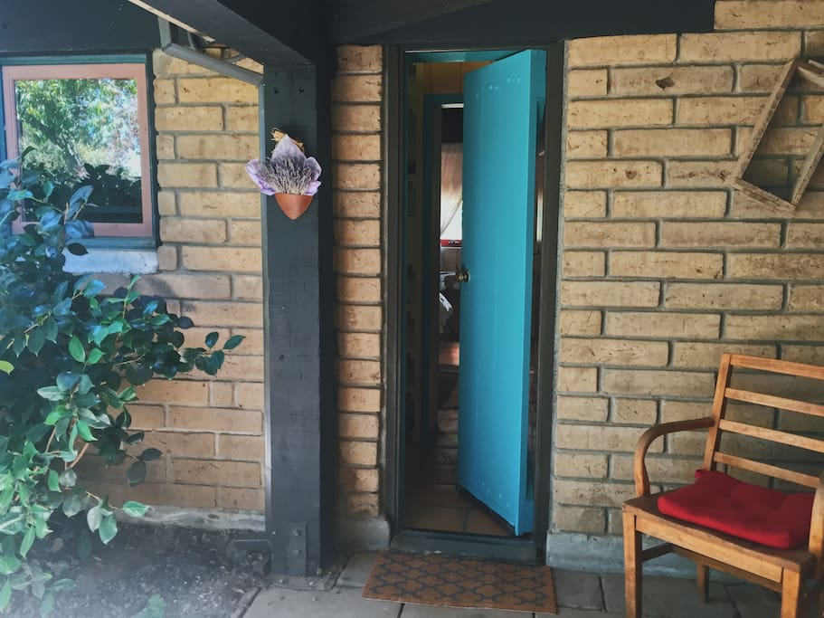 Private entrance through turquoise door to your guest suite.