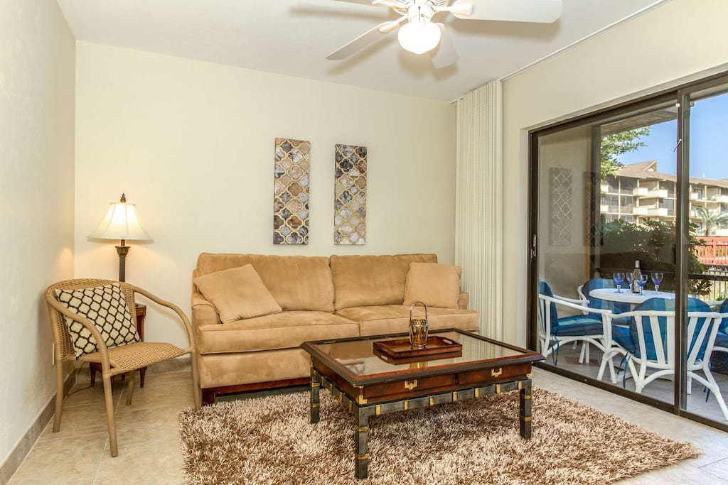 Den w/queen size sofa sleeper (& full size murphy bed) provide direct access to screened lanai via sliding glass doors.