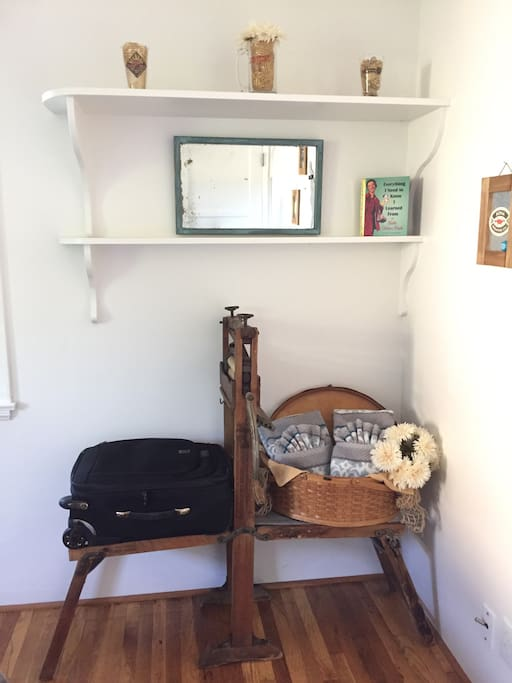 Vintage clothes ringer repurposed to a luggage rack