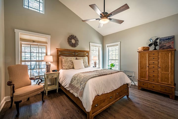 Light and airy master bedroom. Queen-size bed. Cordless cellular shades.