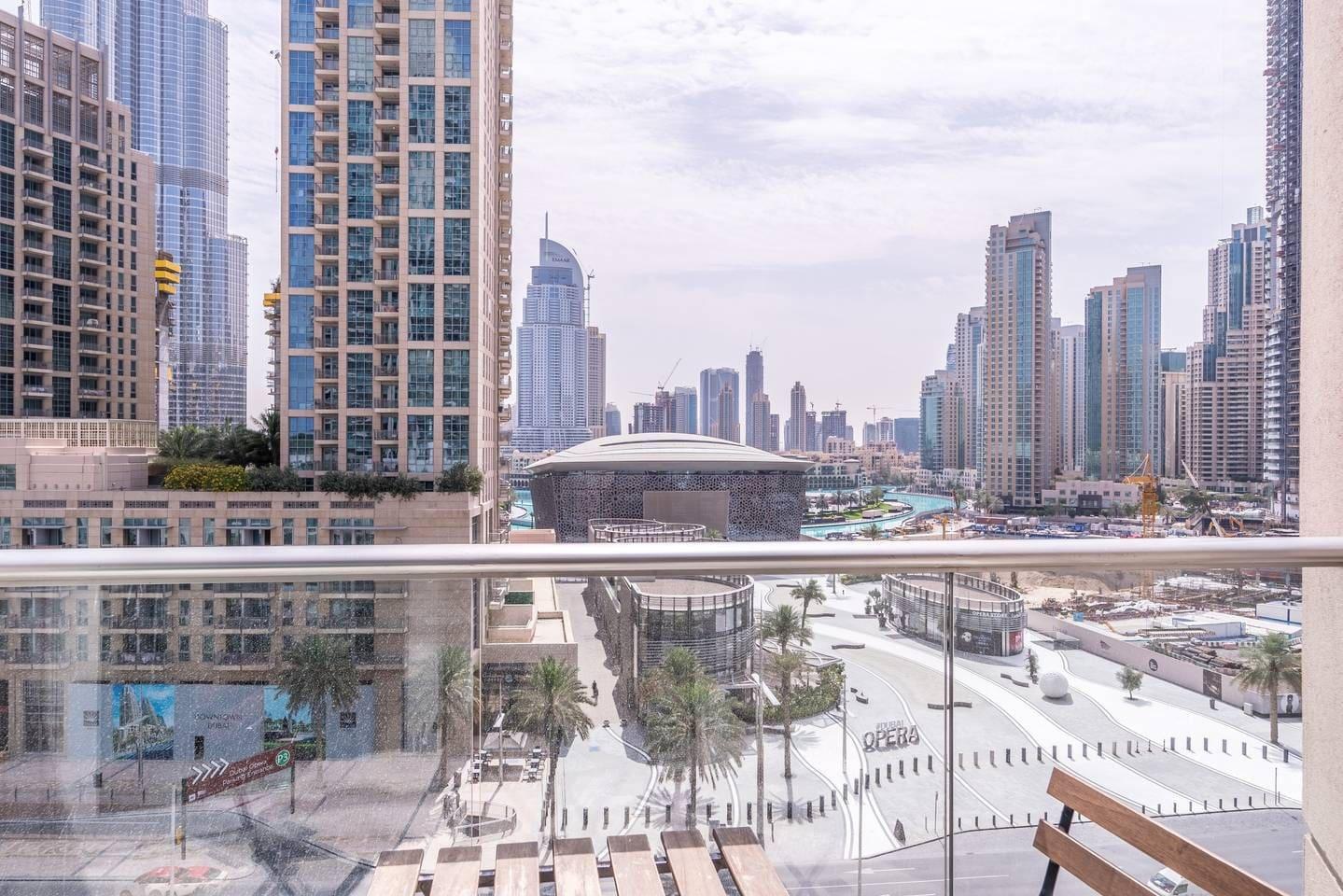 Panoramic view of the Dubai Opera and Burj Khalifa