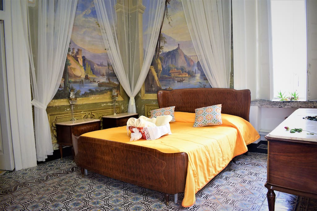 Frescoed bedroom with king-size bed