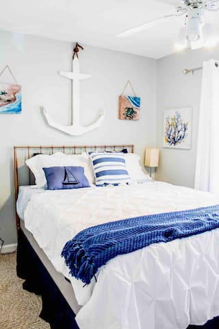 Beach themed queen bed, closet space.  This room is the smallest of the 3 rooms.