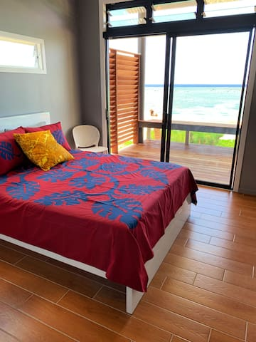 Bedroom 1, with a queen size bed, walk-in wardrobe and full sized bathroom ensuite