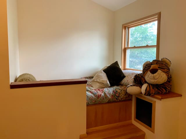 Bedroom one with a captain's twin bed.