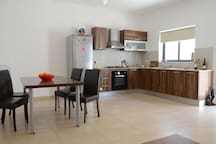 Our lovely and spacious dining room and kitchen - you will find everything you need to cook your delicious meals.