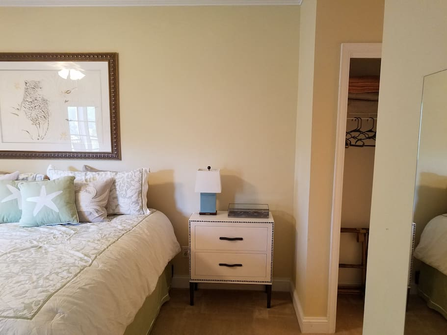 Master bedroom with extremely comfortable mattress, sitting area near windows, and walk-out screen porch.  Flat screen television with Verizon FIOS.  Plus master has shower, soaking tub, and double sinks.