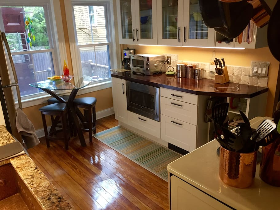 Eat-in kitchen, microwave and counter convection/toaster. Overhead fan.