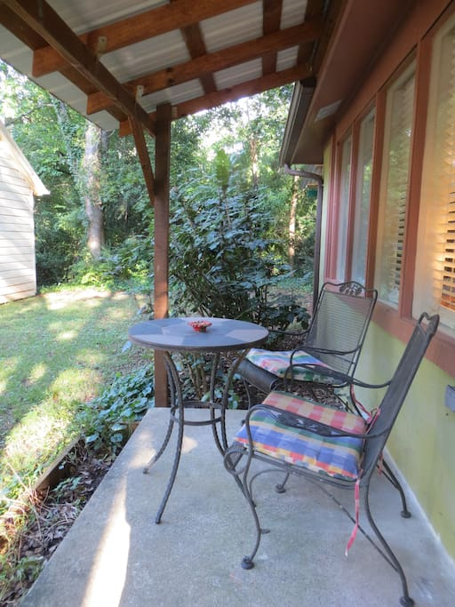 Front porch with metal table and chairs.