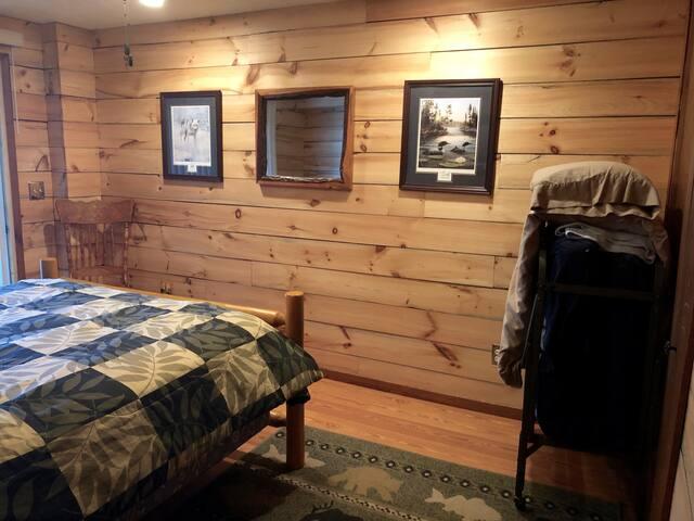 Bedroom 2: Queen bed with cot
