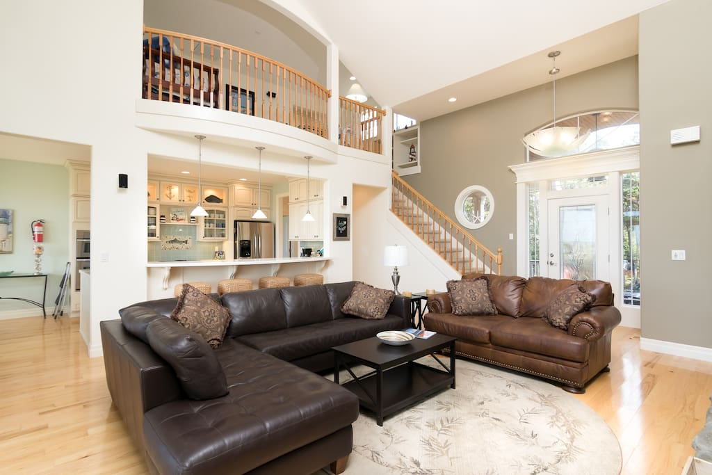 Relax in the expansive living room with open floor plan and vaulted ceilings