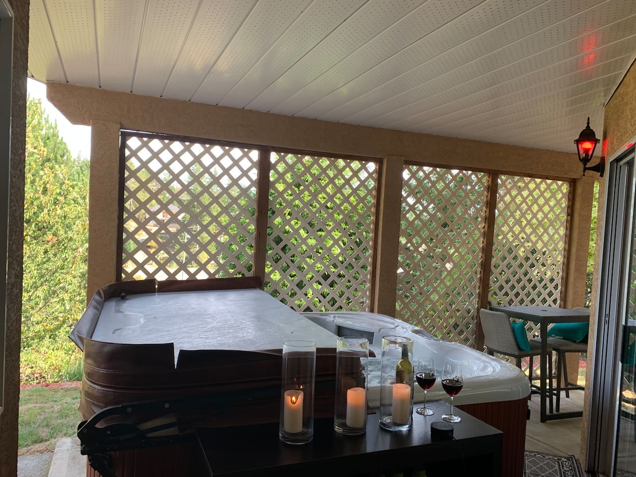 6 person hot tub with Amazon Alexa to keep you entertained while you relax. Bistro patio set to enjoy morning coffee or evening wine while looking out over the view.