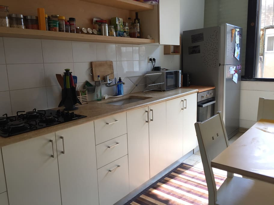 Kitchen+ a small dining area