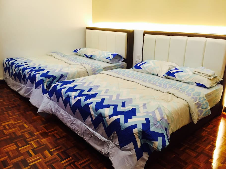 2 new Queen size beds with hotel quality mattresses. The rooms are all fitted with cosy lighting. This room is suitable for family with kids.