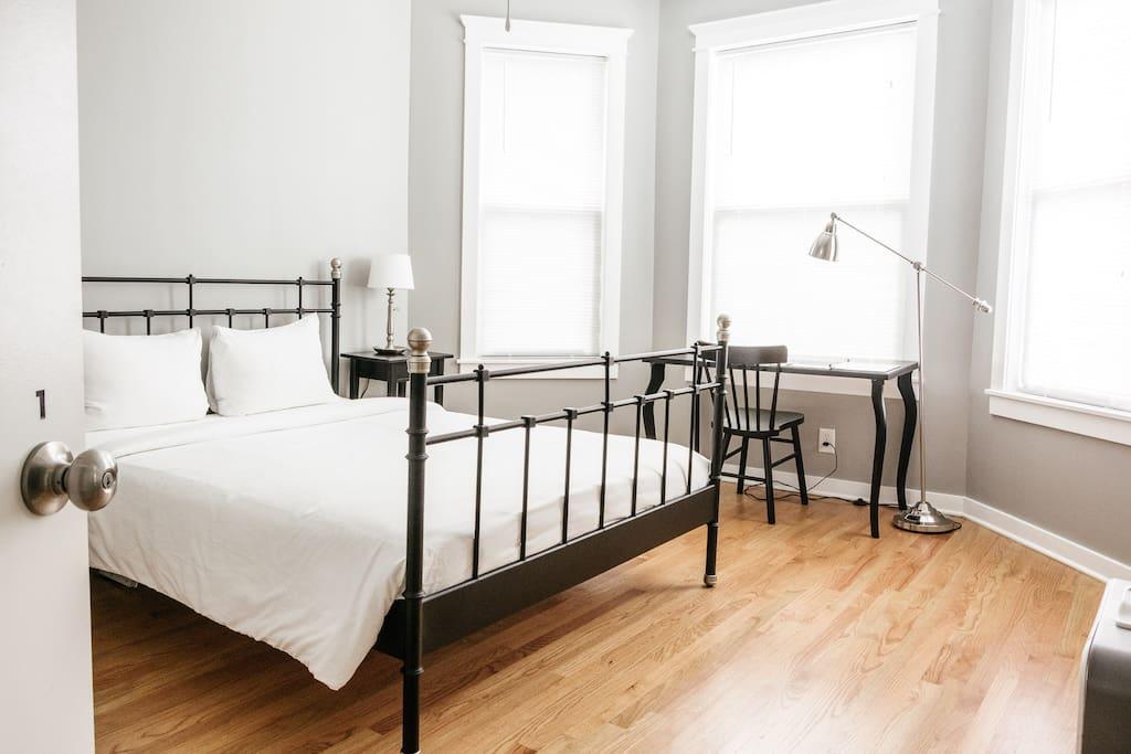 Bedroom sleeps two guests in queen size bed.
