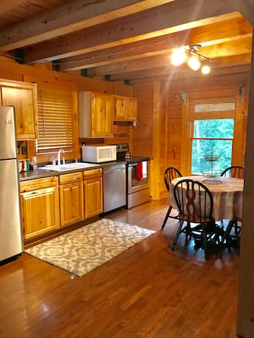 Eat in kitchen with full size stove, fridge, microwave