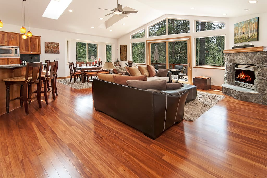 Living room with a fireplace and lots of natural sunlight