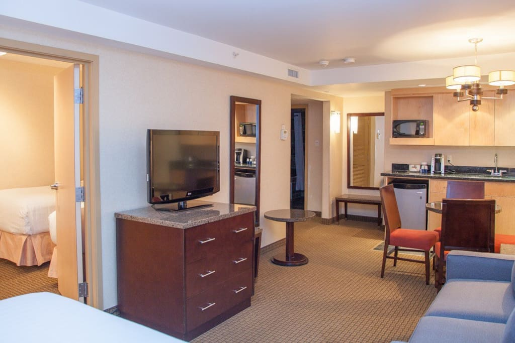 Our Family Suite features a queen & two single beds, sofa bed, dinning table, 2 Tvs and much more.