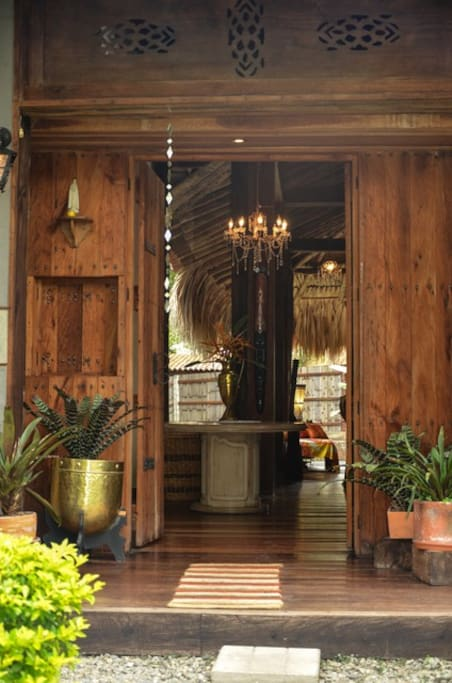 Door of the main entrance made of sustainably harvested tropical hardwood