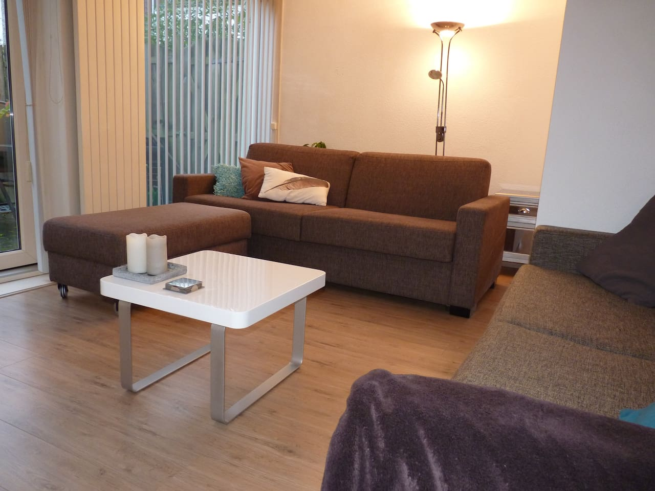 Livingroom with high quality pull out sofa and access to private garden - you will sleep perfectly