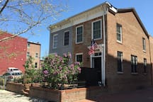 Historic brick rowhouse on a quiet city street in the heart of downtown DC