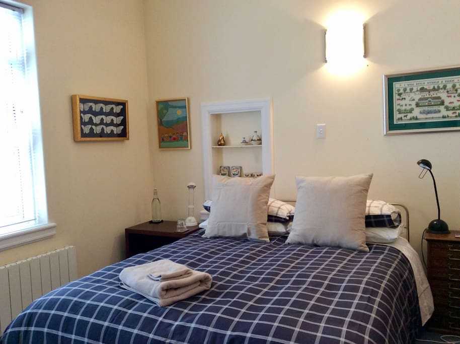 This is your lovely bedroom. The comfortable queen bed was made by a well known designer Bob McDonald