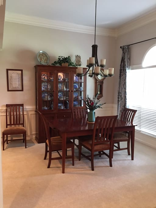 Open formal dining room adjoins living room; table extends to serve eight.