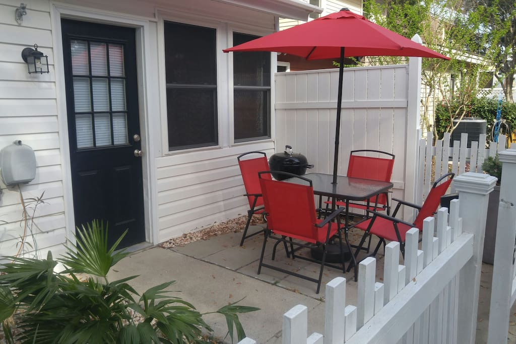 Back patio with table and grill
