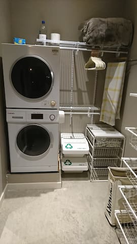 Closet off of bedroom has a washer/dryer, ironing board, iron, laundry basket, extra towels, bath mat, sheets, hand soap, extra pillows, and hangers. We also  provide dryer sheets and a box of laundry detergent on top of dryer for your convenience.