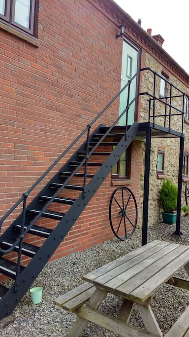 External staircase to upper flat