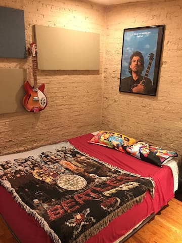 """There are two Queen sized beds in this room, """"Studio 2"""".  For single travelers or couples please check out my other listing """"Beatles Themed Ensuite Room"""" - which has one King sized sleigh bed and attached bath."""