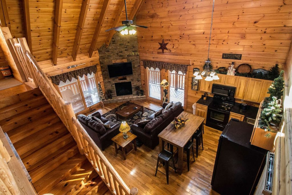 Open Floor Plan with Kitchen High Top Table and Chairs and Easy Access to Wrap-Around Deck